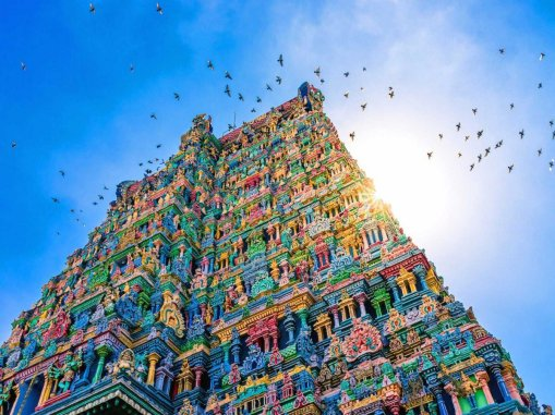 the-meenakshi-temple-is-located-in-tamil-nadu-in-southern-india-and-is-a-beacon-of-bright-blues-yellows-pinks-and-greens-the-incredibly-detailed-layers-of-the-temple-reach-far-into-the-sky